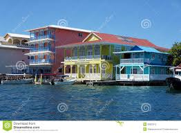 House Over Water Colorful Caribbean Houses Over Water With Boats Stock Photo
