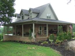 brick house with wrap around porch u0026 siding on upper gables the