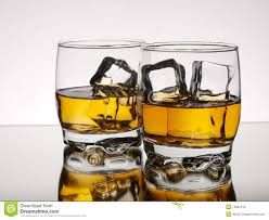 whiskey photography two glasses of whiskey on the rocks stock photography image