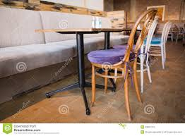 stylish coffee shop with tables and chairs stock photo image