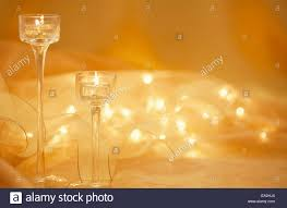elegant glass candle light holders with gold ribbon defocused