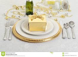 silver and gold table setting with present stock photo image