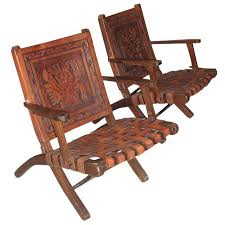 embossed leather folding armchairs a pair chairish