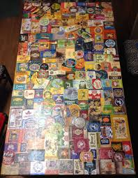 my girlfriend and i stuck craft beer labels to a table for over a