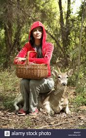 fake deer asian woman sitting on fake deer stock photo royalty free image