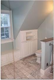 dormer storage ideas bedroom transitional with light gray bedding
