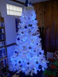 white tree with blue lights also a