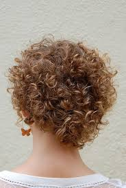 vies of side and back of wavy bob hairstyles cute corkscrew curls with v shaped nape haircut hairstyles weekly