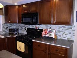 Kitchen With Mosaic Backsplash by Bathroom Decorations Brown Wooden Kitchen Cabinet With Cream
