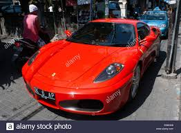 porsche indonesia red porsche lamborghini in the kuta street bali indonesia stock