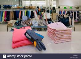 Desk Outlet Store Pricing Store Desk Price Gun On Folded Clothes Of Counter In