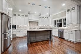 kitchen with stainless steel backsplash kitchen island ikea fruit bowl glass chandeliers brown wooden