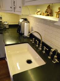 absolute black honed granite counter top bisque farm sink