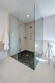 pebble tile shower floor bathroom contemporary with black and