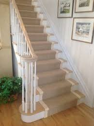 traditional staircase with maeve stair runners high ceiling