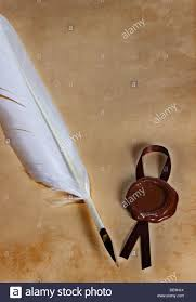 writing parchment paper old paper ancient parchment with wax seal and quill pen stock stock photo old paper ancient parchment with wax seal and quill pen