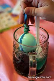 boiling eggs for easter dying melted crayon easter eggs housing a forest