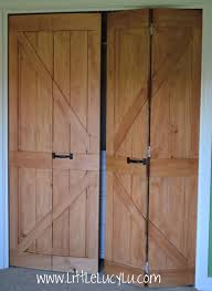 Barn Door Frame by Rustic Dressing Room With Bifold To Barn Doors And White Wooden