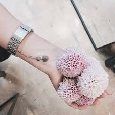pompon dahlia tattoo on the left wrist