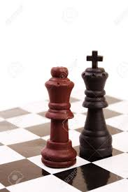 opposite colours king and queen of opposite colours on the chessboard stock photo
