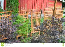 wood trellis covering red barn fencing stock image image 74266625