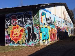 foundation walls project provides space to asheville s street this flower is inspired by vintage sailor jerry tattoo style artwork tags adjacent include
