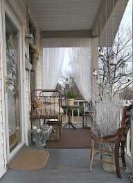 elegantly furnished verandah with antique wrought iron bed and