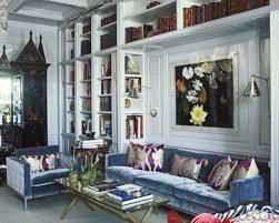 how to decorate around a blue velvet sofa