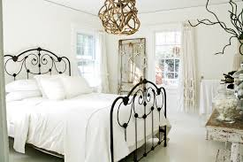 Shabby Chic Guest Bedroom - wrought iron fleur de lis staircase mediterranean with wooden
