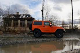 orange jeep jeep wrangler with 350 hp tuned by geiger cars freshness mag
