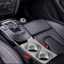 audi cup holder sketch depicting maksimatic cup holder within center console of