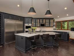 small kitchen black cabinets black stools pendant lighting wood beams office in kitchen dark