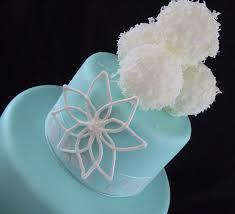 fondant wedding cake tiffany blue with snow flake and snow ball