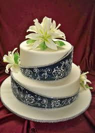 navy blue and white elegant wedding cake with oriental sugar