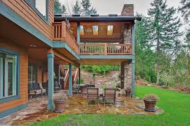 Rustic Outdoor Rugs Two Story Fireplace Deck Rustic With Skylights Traditional