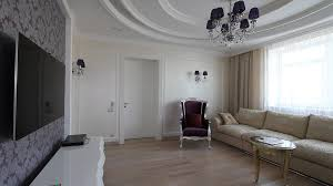 day room with tv karaoke sofas and piano view showcase of