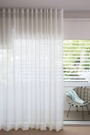 stunning sheer white linen curtains overlaying sleek helioscreen