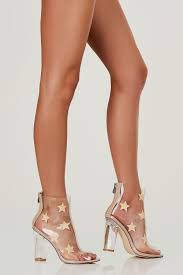 clear ankle booties with peep toe finish star prints throughout
