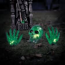 skeleton dog halloween prop 2 u0027 orange skull with hand halloween prop halloween decoration