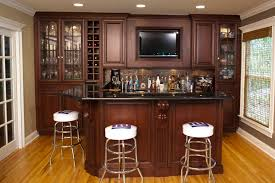rustic luxury home bar and game room with stone pillars and wood