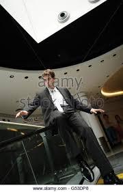 Sliding Down A Banister Man Sliding Down Slide Stock Photos U0026 Man Sliding Down
