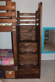 Diy Bunk Beds With Stairs White Bunkbed With Bookshelves Stairs And Storage Bins