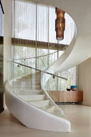 this white sculptural spiral staircase entices you upstairs in