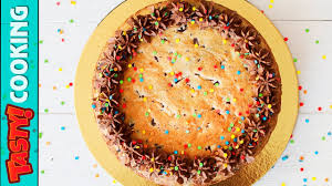 giant butter cookie chocolate chunk cookie cake recipe tasty