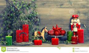 christmas decorations with red candles and vintage toys stock