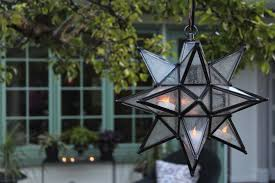 battery operated star lights olivia star pendant in garden