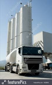 industrial architecture cement factory with silos and mixer truck