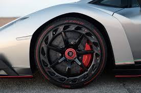 gold lamborghini veneno lamborghini veneno front wheel detail in carbon fiber and red