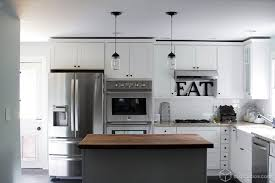 white kitchen with black island multi tone kitchen the finish the style