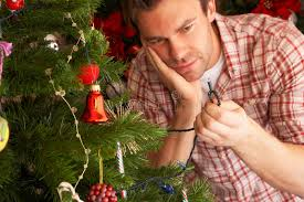 fixing christmas tree lights young man trying to fix christmas tree lights stock image image of